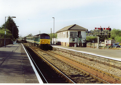 In 2002 First Great Western were still running loco hauled trains from Penzance to Paddington. 47832 passes the platform mounted signalbox working 1A45 0820 off Penzance to London.