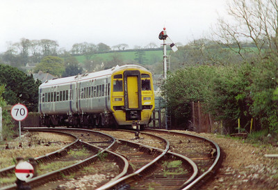 An Alpha Line liveried class 158 sprinter unit, 158835, runs past the inner home lower quadrant semaphore signal with train 1C91 0800 Cardiff Central to Penzance.
