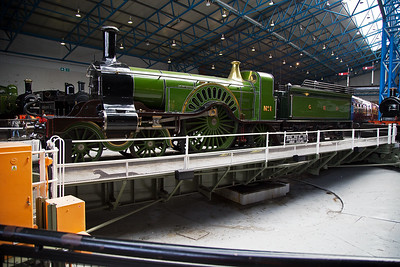 Inside the Great Hall and Patrick Stirling's 4-2-2 masterpiece  No1 takes pride of place on the turntable.  The 1870 vintage loco was restored to working order in the 1980's.  The driving wheels are a whopping 8 foot 1 inch in diameter.