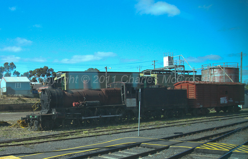 Loco D3 619 at Bendigo.  (Taken from train)  Built at Bendigo workshops 1919/20 (eight in class)  - Loco now moved to Maldon by road 5th Jan 2012 (just over a month after this photo was taken)