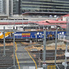 Pacific National locos passing through Roma street - poles in wrong place for Number!