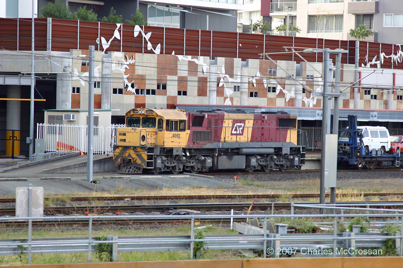 Loco 4990 at Roma St having attached motorrail section to north bound Sundowner