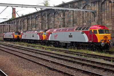 At the back of Carlisle Citadel station are three Virgin West Coast Thunderbird locos, 57313, 57311 and 57304.