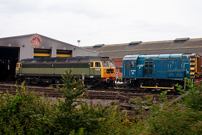 Two tone green D1916 and 08868 stand outside the main LNWR maintenance shed at Crewe between the Stoke line and the main WCML.