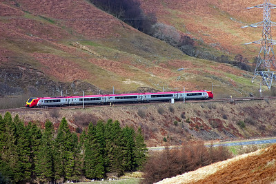 An unknown class 221 Super Voyager set climbs the 1 in 174 gradient of Greskine Bank with ease.  The service is 1S36 0703 Birmingham New Street to Glasgow Queen Street.  Beattock Summit is a few short miles away.
