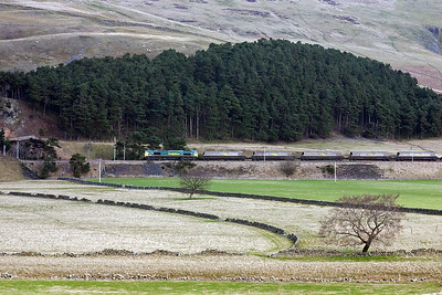 A short time after the steam working had passed, a northbound coal working comes north with Freightliner Heavy Haul 66564 fronting 4S12 0335 Drax Power Station to Ravenstruther empty HHA bogie coal hoppers.