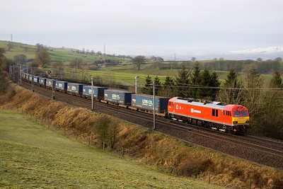 A few minutes later 92015 passes with 4S43 Daventry-Mossend Tesco train.   28/1/12