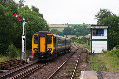156428 departs for Buxton some 10 minutes late. The 20 leverframe signalbox was built by BR in 1957 to replace the Midland Railway 'box destroyed by the tender of 48188. The signalman was unhurt having evacuated the 'box. So why didn't guard John Creamer leave his brakevan?