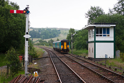 Back at Chapel-en-le-Frith and 156454 runs past the signalbox and slows for its station stop forming 2N91 1437 Buxton to Blackpool North.
