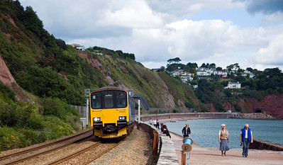 150120 heads the 12:52 Exeter St Davids to Plymouth service at Teignmouth.