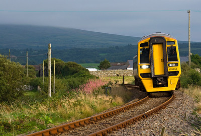 158834 approaches Llandanwg Station with the 14:08 Birmingham International to Pwllheli service. However as nobody wished to get on or off it didn't stop.