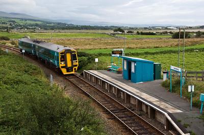 158829 with the 14:08 Birmingham International to Pwllheli service passing Llandanwg station.