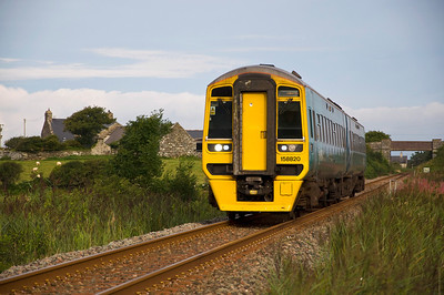 158820 with the 07:20 Pwllheli to Birmingham International service between Llandanwg and Pensarn.
