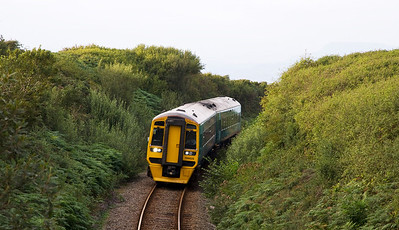 158829 with the 17:45 Pwllheli to Machynlleth service near Llandanwg.