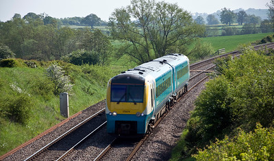 175011 with the Arriva Trains Wales 1V74 07:30 Manchester Piccadilly to Carmarthen service approaching the bridge at Kilpeck.