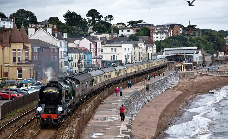 """34046 """"Braunton"""". A West Country Class former Southern Region steam engine heads the 07:55 Bristol Temple Meads to Kingswear special. with Dawlish Station in the distance."""