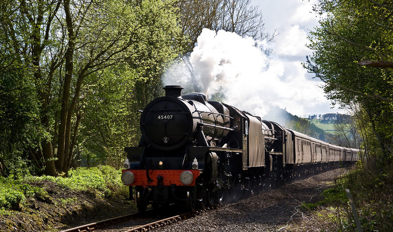 LMS Black Fives 45407 and 44871 with a special from Paddington to Llandrindod Wells on the 12th of May 2012.. Steam took over from Newport as the special made it's way to Llandrindod Wells via the South Wales Mainline. Seen here east of Knighton as they complete their final leg to Shrewsbury, where diesel power will take the train back to London.