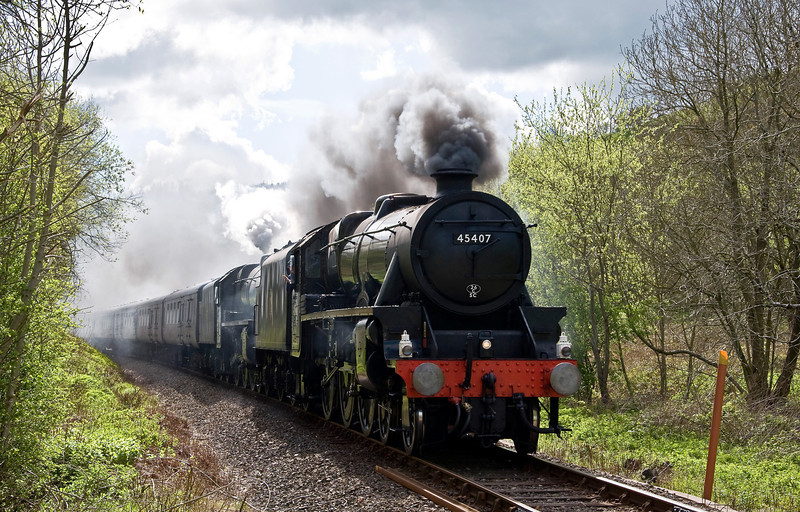 LMS Black Fives 45407 and 44871 with a special from Paddington to Llandrindod Wells on the 12th of May 2012. Steam took over from Newport as the special made it's way to Llandrindod Wells via the South Wales Mainline. Seen here west of Knucklas as they complete their final leg to Shrewsbury where diesel power will take the train back to London.