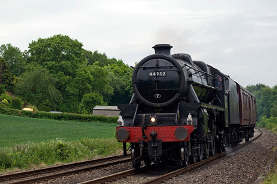 LMS Black 5 44932 heads back to Carnforth with its support coach after hauling the previous days Royal Duchy service from Bristol Temple Meads to Par. Seen here at Powells Crossing on the 17th of June 2013.
