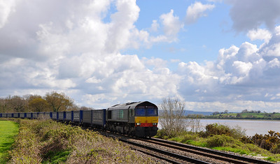 66423 with the 4V38 Daventry-Wentloog 'Tesco Express' near Purton with the River Severn in the distance.