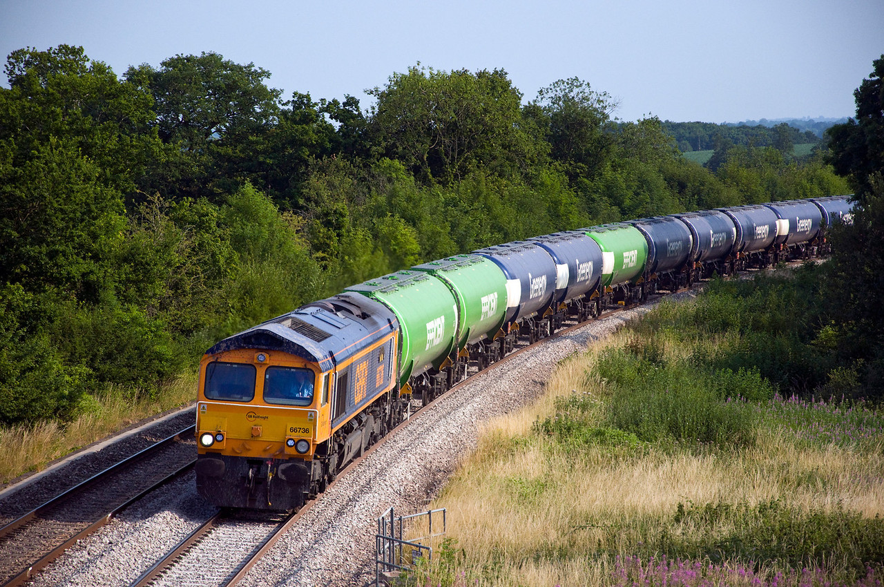 GBRf's 66736 heads 6E12 the 14:57 Cardiff Docks to Peterborough Greenenergy tanks.