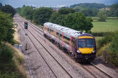 170639 with the 11:45 Cardiff Central to Derby service near Churcham on the 28th of July 2013.
