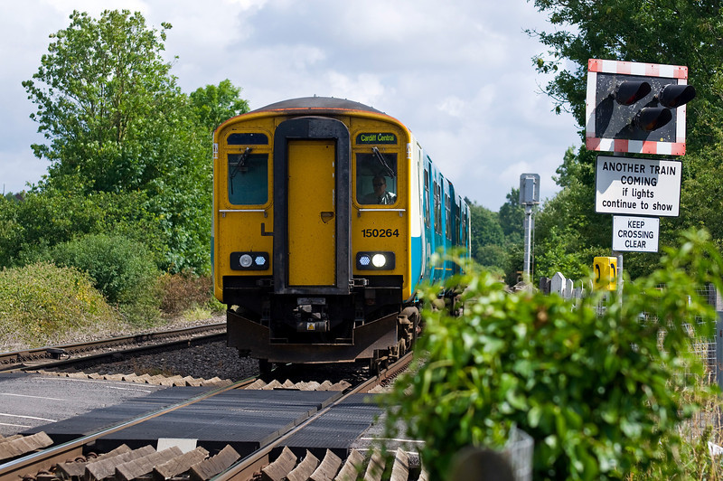 150264 with the 10:48 Gloucester to Cardiff Central service. Seen here on the 28th July 2013 near Grange Court.