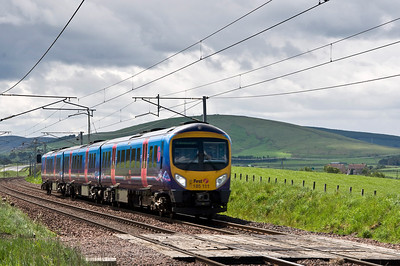 185111 with First Transpenine's 1S46 10:00 service from Manchester Airport to Edinburgh service at Wandel.