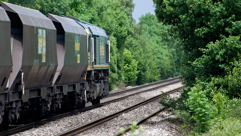 Not normally a fan of going away shots but quite liked this one of 66620 with the 10:50 Portbury Coal Terminal Fhh to Rugeley B Power Stn. Seen here at Howton on the 17th of June 2013.
