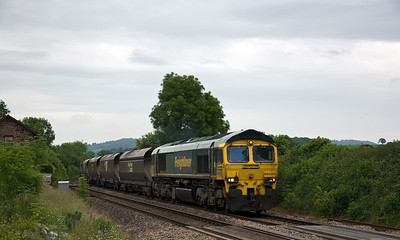 66523 running 131mins late with 6M55 the 07:00 Portbury Coal Terminal to Rugeley B Power Stn. Seen here at Penpergwm on the 17th of June 2013.
