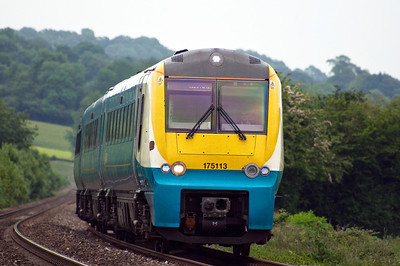 175113 with the  09:30 Manchester Piccadilly to Carmarthen service, seen here at Powells Crossing on the 17th of June 2013.