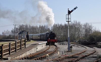 """Hunslet Austerity 3806 """"Wilbert"""" leaves Lydney Junction station on the Dean Forest Railway."""