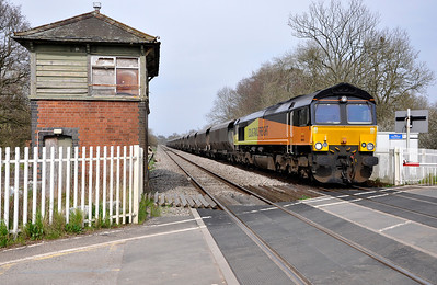 Colas Rails 66846 with the 15:25 Redcar B.S.C. to Port Talbot Grange service. Seen here at Awre Level Crossing.