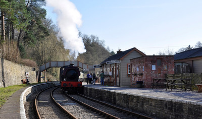 "Hunslet Austerity 3806 ""Wilbert"" arrives at Parkend Station on the Dean Forest Railway."