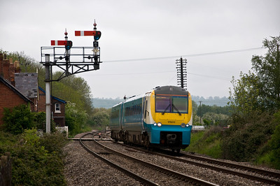 175011 with the 1V55 0820 service from Holyhead to Cardiff Central seen here at Moreton-on-Lugg on the 19th of May 2012.