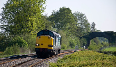 DRS 37608 light engine move from Crewe - Keyham. Heard long before it was seen here just north of Tram Inn on the 22nd of May 2012.