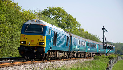 """67001 hauls 1V31 the 0532 Holyhead to Cardiff Central """"WAG"""" service near Tram Inn on the 22nd of May 2012."""