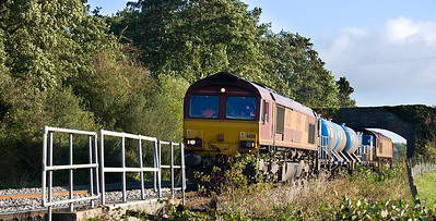 66126 at the front and 66027 on the rear of the 3S59  07:46 Moreton on Lugg to Weston super Mare  RHTT. Seen here at near Tram Inn on the 17th of October 2012.