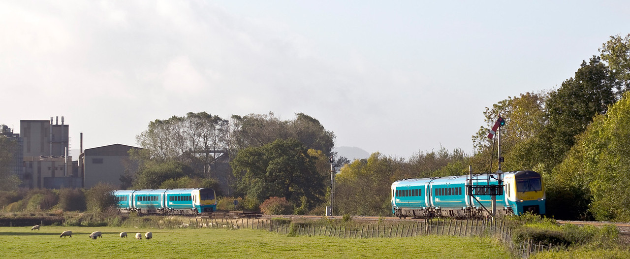 175008 heads south with the 06:28 Holyhead to Cardiff Central service whilst 175002 heads north with the 09:21 Cardiff Central to Holyhead service. seen here near Tram Inn on the 17th of October 2012.