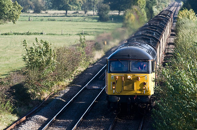 56094 on the 17th of October 2012 with a late running empty logs from Chirk to Baglan, seen here just north of Tram Inn.