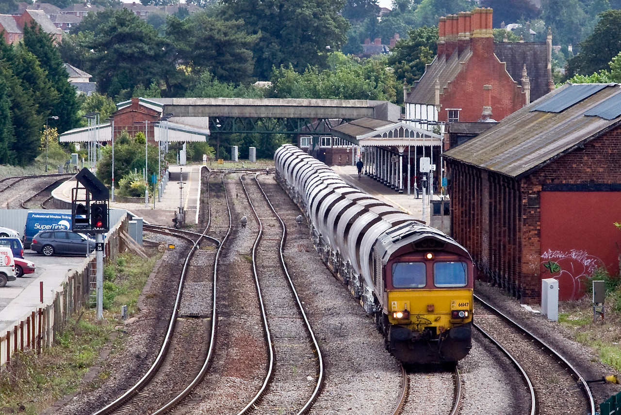 66147 with 6M60 Exeter Riverside to Bescot China Clay, seen here at Hereford waiting for it's path up the Marches.