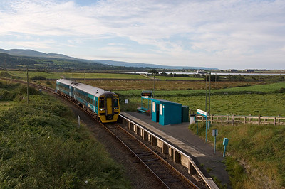 158834 with the 06:47 Machynlleth to Pwllheli service at Llandanwg.