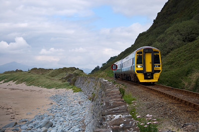 158841 with the 11:30 Pwllheli to Birmingham International service. Approaching the footpath that runs down the cliff and crosses the railway to the beach.