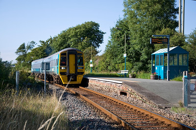 158818 arrives at Pensarn station with the 15:37 Pwllheli to Machynlleth service. Pensarn station is a request stop but nobody requested it.