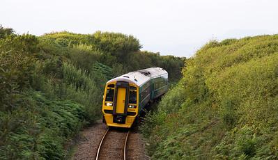 158829 with the 17:45 Pwllheli to Machynlleth service near Llandanwg.