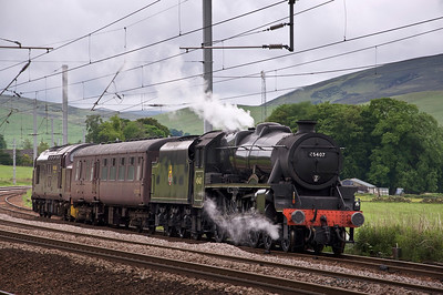 """4-6-0 LMS Black 5 45407 """"The Lancashire Fusilier"""" waits in the loop at Abington on the second part of its journey from Grosmont to Fort William, having stopped overnight at Carlisle. Originally it had been planned to move on the 15th but the delay meant that as we pulled off the M74 on our way from Inverness to Gloucestershire there it was, waiting."""