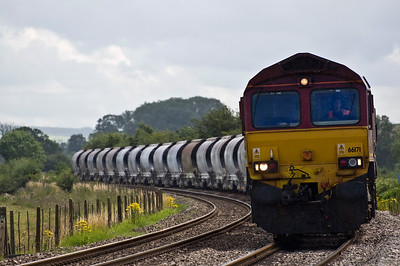 66171 with 6M60 Exeter Riverside to Bescot China Clay, seen here approaching Moreton on Lugg.