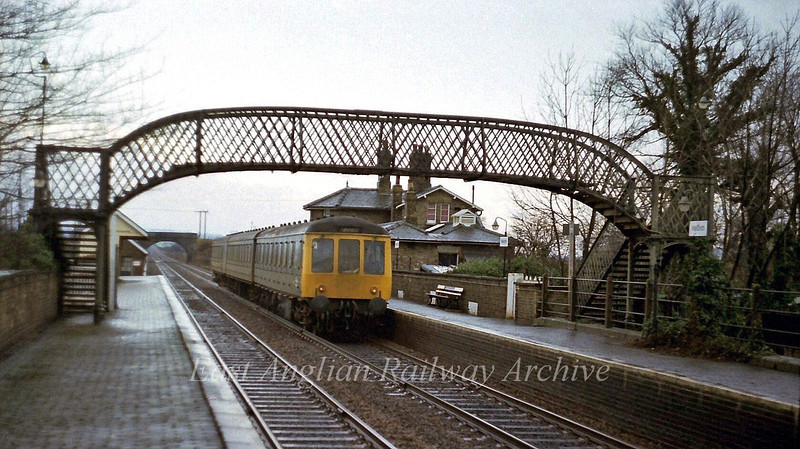 A Kings Cross to Cambridge dmu passes Meldreth.  28th January 1978