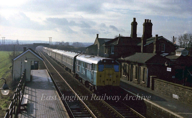 In far from perfect lighting conditions with a low winters sun, 31190 passes Meldreth with the 1125 Kings Cross to Cambridge on the last day of through hauled services. 5th February 1978.
