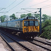 A class 312 emu approaching Ashwell and Morden with the 1108 Royston to Kings Cross. 18th May1980